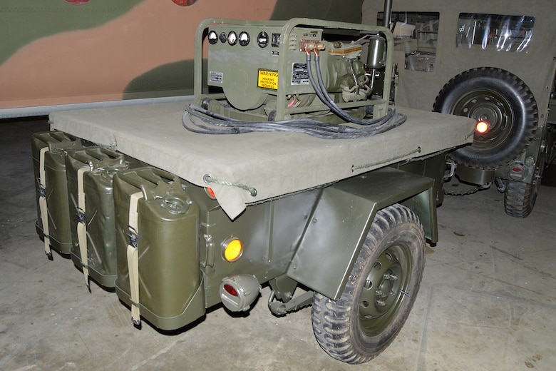 DAYTON, Ohio -- Generator and trailer for the AN/MRC-108 Communication System on display in the Southeast Asia War Gallery at the National Museum of the U.S. Air Force. (U.S. Air Force photo)