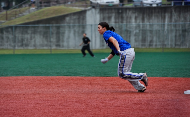 Senior Airman Amber Devlin, 694th Intelligence, Surveillance and Reconnaissance Group program manager, runs to third base during the fifth inning of a softball game against the 3rd Battlefield Coordination Detachment Sept. 29, 2014, on Osan Air Base, Republic of Korea. Devlin was selected to be a part of the 15-player roster on the Air Force's Women's softball team. (U.S. Air Force photo by Senior Airman David Owsianka)