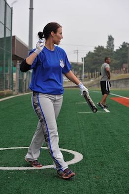 Senior Airman Amber Devlin, 694th Intelligence, Surveillance and Reconnaissance Group program manager, walks to the plate during the fourth inning of a softball game against the 3rd Battlefield Coordination Detachment Sept. 29, 2014, on Osan Air Base, Republic of Korea. Devlin was selected to be a part of the 15-player roster on the Air Force's Women's softball team. (U.S. Air Force photo by Senior Airman David Owsianka)