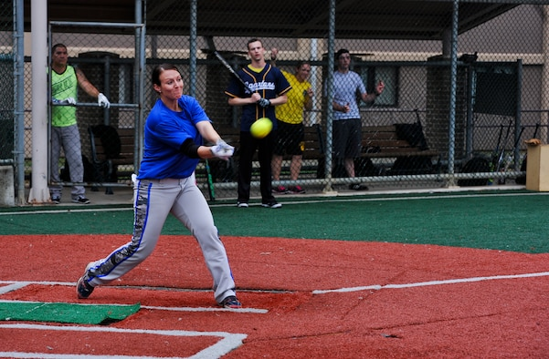 Senior Airman Amber Devlin, 694th Intelligence, Surveillance and Reconnaissance Group program manager, hits the ball into the outfield during the fifth inning of a softball game against the 3rd Battlefield Coordination Detachment Sept. 29, 2014, on Osan Air Base, Republic of Korea. Devlin was selected to be a part of the 15-player roster on the Air Force's Women's softball team. (U.S. Air Force photo by Senior Airman David Owsianka)