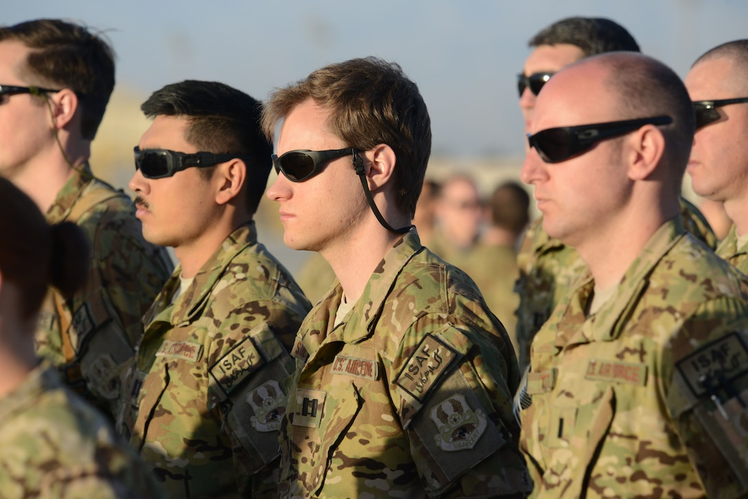 U.S. Airmen and Soldiers assigned to 4th Expeditionary Reconnaissance Squadron stand in formation prior to being re-designated Joint Task Force Thor during the transition of authority ceremony at Bagram Airfield, Afghanistan Oct. 1, 2014. (U.S. Air Force photo by Master Sgt. Cohen A. Young/Released)