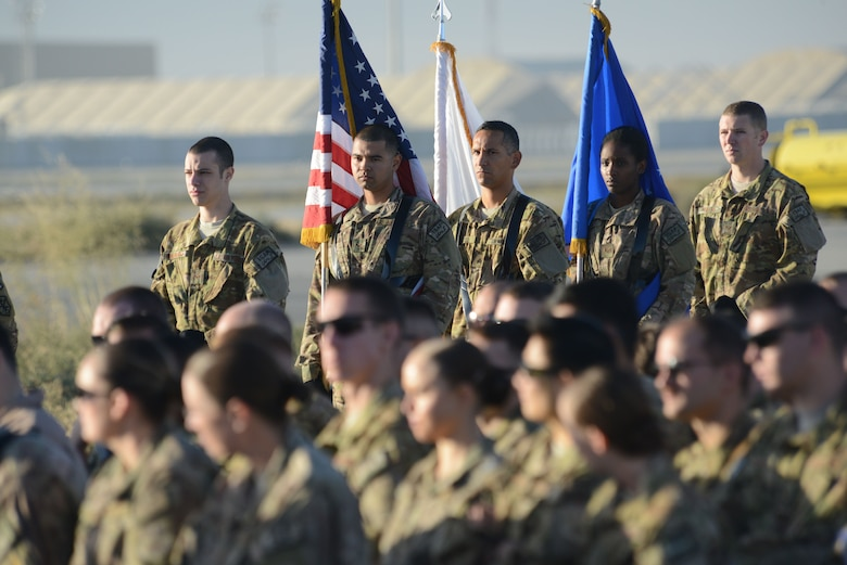 455th Air Expeditionary Wing honor guardsmen stand by waiting for the start of the MC-12W transition of authority ceremony on the flight line of Bagram Airfield, Afghanistan Oct. 1, 2014. The 4 ERS inactivated and Joint Task Force Thor is now the lead for the MC-12W mission in Afghanistan. (U.S. Air Force photo by Master Sgt. Cohen A. Young/Released)