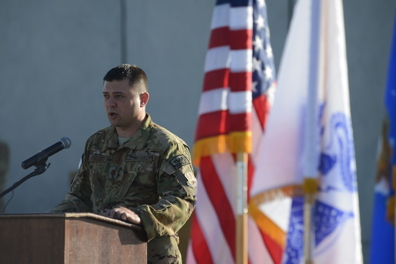 U.S. Air Force Maj. Tanner Woolsey, 4th Expeditionary Reconnaissance Squadron commander, speaks during the MC-12W transition of authority ceremony at Bagram Airfield, Afghanistan Oct. 1, 2014. The 4 ERS inactivated and Joint Task Force Thor is now the lead for the MC-12W mission. (U.S. Air Force photo by Master Sgt. Cohen A. Young/Released)