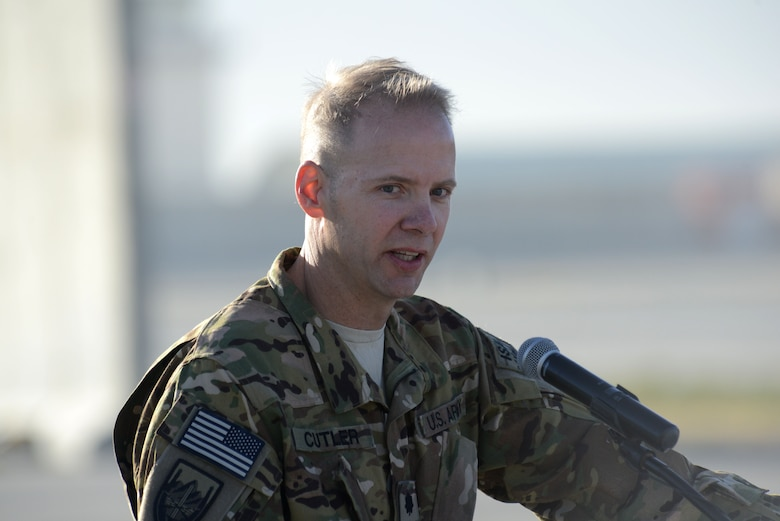 U.S. Army Lt. Col Christopher S. Cutler, commander 306th Military Intelligence Battalion, Joint Task Force Odin, makes closing remarks during the MC-12W transition of authority ceremony at Bagram Airfield, Afghanistan Oct. 1, 2014. The 4 ERS inactivated and Joint Task Force Thor is now the lead for the MC-12W mission. (U.S. Air Force photo by Master Sgt. Cohen A. Young/Released)