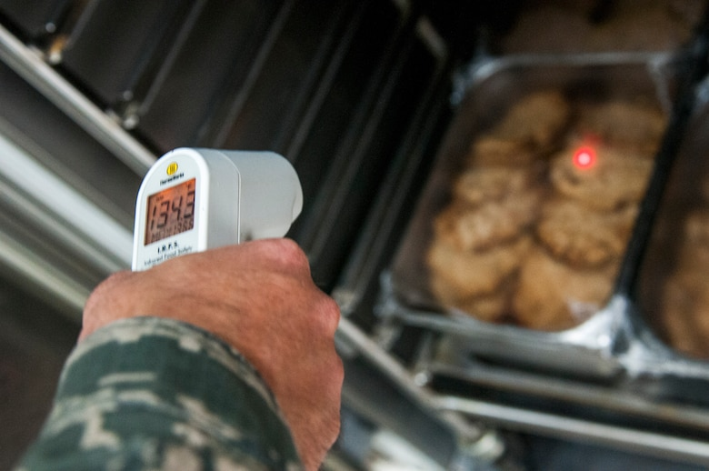 Air Force Staff Sgt. James Rodenberg, 386th Expeditionary Medical Group public health technician takes the temperature of cooked food during his inspection of the main dining facility at The Rock Sept. 23, 2014. Rodenberg conducts inspections two times each month at both dining facilities to promote good personal hygiene across the base and to ensure that facilities are operating in accordance with governing regulations. He deployed from 96th Aerospace Medicine Squadron Eglin Air Force Base, Fla., in support of Operation Enduring Freedom and is a native of Crestview, Fla. (U.S. Air Force photo by Senior Master Sgt. Allison Day)