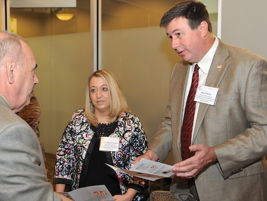 Len Iseldyke from D2Team-Sim discusses his firm's capabilities with Crystal Bennett-Echols and Wes Turner of the Installation Support and Programs Management Directorate's Medical Division programs during the center's Small Business Forum Oct. 15 at Jackson Center in Cummings Research Park.