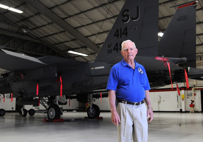 """Retired Lt. Col. Robert Pardo in front of a 333rd Fighter Squadron F-15E Strike Eagle during a tour of Seymour Johnson Air Force Base, North Carolina, Oct. 10, 2014. Pardo is known for his """"Pardo's Push"""" maneuver as a 433rd Tactical Fighter Squadron F-4 Phantom pilot stationed at Ubon Royal Thai AFB, Thailand, when he saved another F-4 aircrew from having to eject in North Vietnam by pushing their plane in the air over the Laotian border and into relative safety. (U.S. Air Force photo/Airman 1st Class Ashley J. Thum)"""