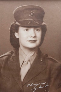 An old photograph of Georgina Banks hangs on the wall in Michael Banks' living room in Berlin, Wis.  Georgina and Michael enlisted in the Marine Corps in 1943 during World War II.  Georgina was a huge support system for Michael during their time in the Marine Corps and helped him move on with life after the war.
