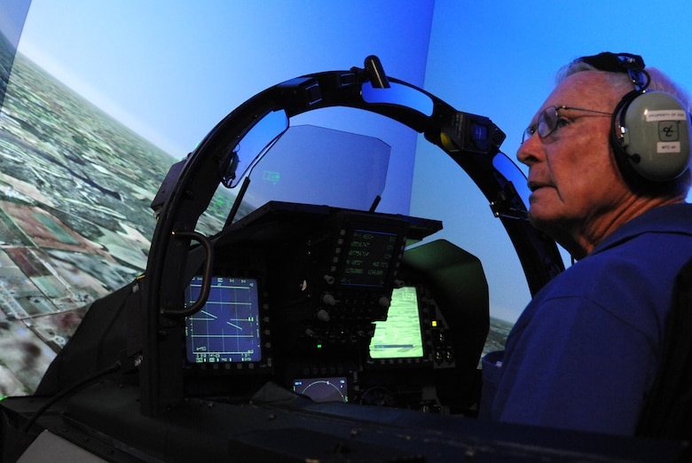 Retired Lt. Col. Robert Pardo surveys the surrounding area while in the F-15E Strike Eagle simulator at Seymour Johnson Air Force Base, N.C., Oct. 14, 2014. Pardo toured the base during his visit and spoke to the graduating pilots and weapons systems operators of the F-15E Basic Course. (U.S. Air Force photo/Airman 1st Class Ashley J. Thum)
