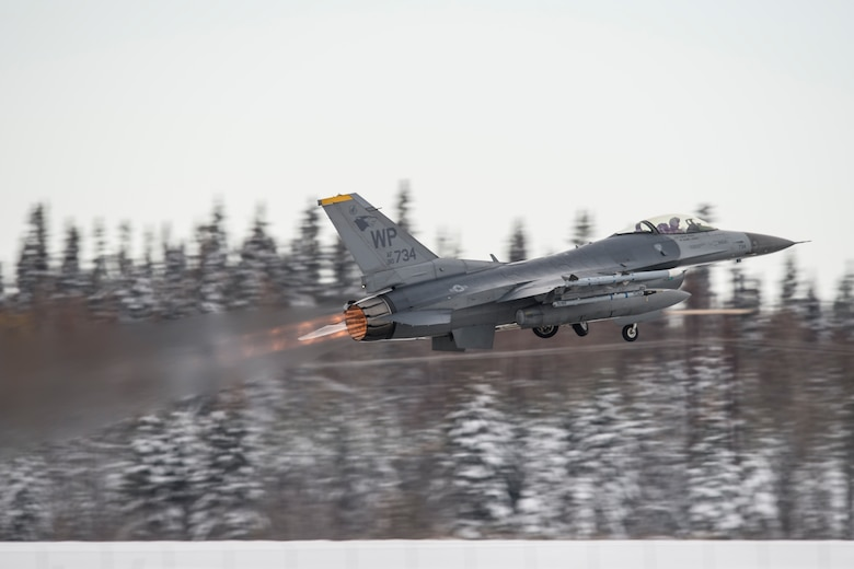 An Air Force F-16 Fighting Falcon assigned to the 35th Fighter Squadron, Kunsan Air Base, South Korea, takes off for a sortie Oct. 6, 2014, at Eielson Air Force Base, Alaska, during Red Flag-Alaska 15-1. RF-A is a series of Pacific Air Forces commander-directed field training exercises for U.S. and partner nation forces, providing combined offensive counter-air, interdiction, close air support and large force employment training in a simulated combat environment. (U.S. Air Force photo/Senior Airman Peter Reft)