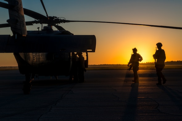 Pararescuemen walk toward an HH-60G Pave Hawk Oct. 9, 2014, at Avon Park Air Force Range, Fla. The PJs, from the 38th Rescue Squadron, are trained in emergency medical tactics as well as combat and survival skills. (U.S. Air Force Photo/Airman 1st Class Ryan Callaghan)