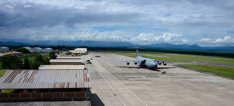 Crew members of a C-5 Galaxy from Westover Air Reserve Base, Mass., prepare to unload their cargo of donated goods Oct. 11, 2014, at Soto Cano Air Base, Honduras. The cargo transporting aircraft delivered over 6,000-pounds of humanitarian aid and supplies that were donated to Honduran citizens in need through the Denton Program. The Denton Program allows private U.S. citizens and organizations to use space available on U.S. military cargo planes to transport humanitarian goods to approved countries in need. (U.S. Air Force photo/ Tech. Sgt. Heather Redman)
