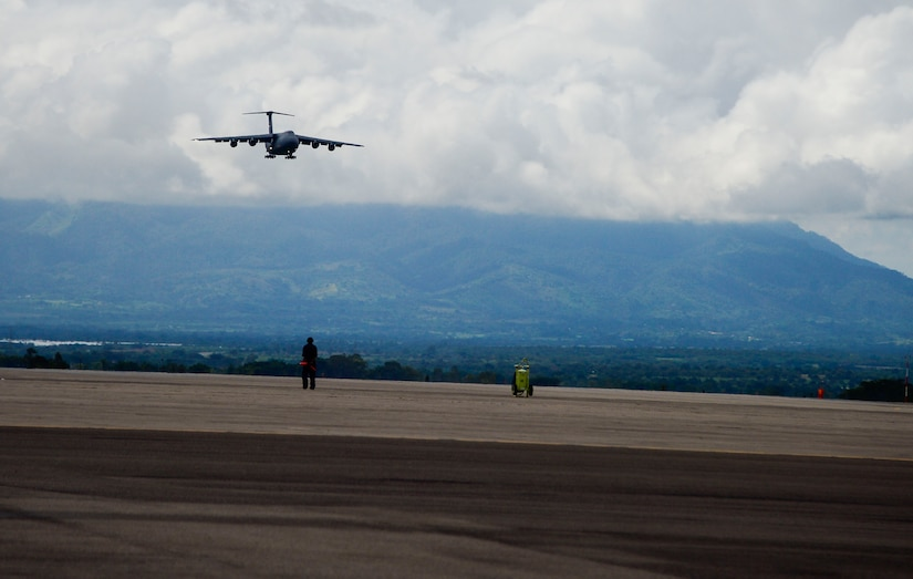 A C-5 Galaxy from Westover Air Reserve Base, Mass., approaches Soto Cano Air Base, Honduras, Oct. 11, 2014.  The cargo transporting aircraft delivered over 6,000-pounds of humanitarian aid and supplies that were donated to Honduran citizens in need through the Denton Program.  The Denton Program allows private U.S. citizens and organizations to use space available on U.S. military cargo planes to transport humanitarian goods to approved countries in need. (U.S. Air Force photo/Tech. Sgt. Heather Redman)