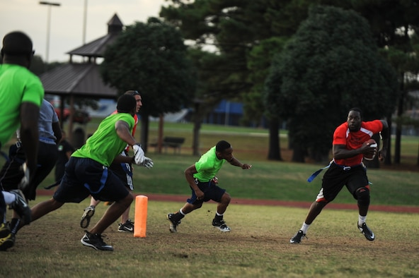 Senior Airman Ernest Opoku quarterback for the 19th Civil Engineer Squadron, scrambles out of the pocket during an intramural flag football game Oct. 9, 2014, at Little Rock Air Force Base, Ark. The 19th CES went on to lose 19-6. (U.S. Air Force photo by Airman 1st Class Cliffton Dolezal)