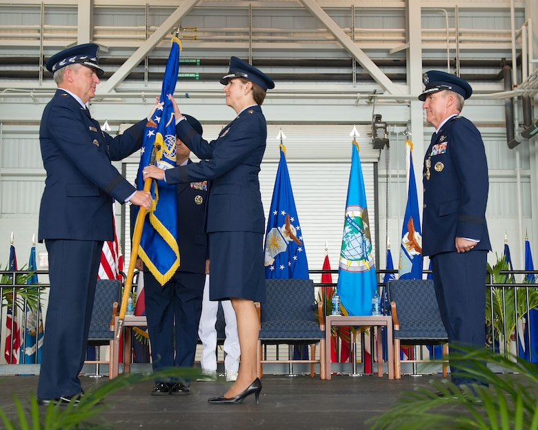 Gen. Hawk Carlisle, outgoing Pacific Air Forces commander, relinquishes the PACAF flag to Air Force Chief of Staff Gen. Mark A. Welsh III during the PACAF change of command ceremony Oct. 16, 2014, at Joint Base Pearl Harbor-Hickam, Hawaii. Gen. Lori Robinson became the first woman to lead a U.S. Air Force Component Major Command when she succeeded Carlisle during the ceremony. (U.S. Air Force photo/Tech. Sgt. James Stewart)