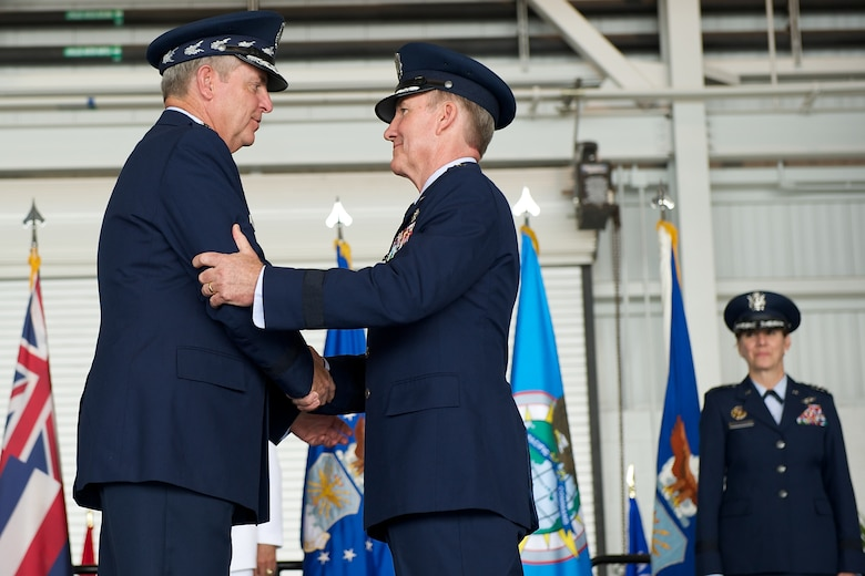 Air Force Chief of Staff Gen. Mark Welsh III congratulates Gen. Hawk Carlisle, outgoing Pacific Air Forces commander, during the PACAF change of command ceremony Oct. 16, 2014, at Joint Base Pearl Harbor-Hickam, Hawaii. Carlisle led Airmen spread across half the globe, serving principally in Japan, Korea, Hawaii, Alaska and Guam. (U.S. Air Force photo/Tech. Sgt. James Stewart)