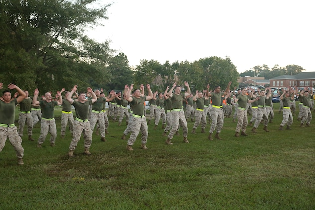 Marines with Headquarters and Service Company, Ground Combat Element Integrated Task Force, conduct side-straddle hop exercises after a three-mile run aboard Marine Corps Base Camp Lejeune, North Carolina, Oct. 17, 2014. Non-commissioned officers within the task force led the unit in the exercises. From October 2014 to July 2015, the Ground Combat Element Integrated Task Force will conduct individual and collective skills training in designated combat arms occupational specialties in order to facilitate the standards based assessment of the physical performance of Marines in a simulated operating environment performing specific ground combat arms tasks. (U.S. Marine Corps photo by Cpl. Paul S. Martinez/Released)