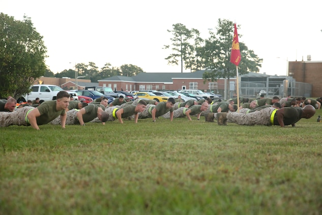 Marines with Headquarters and Service Company, Ground Combat Element Integrated Task Force, conduct push-up exercises after a three-mile run aboard Marine Corps Base Camp Lejeune, North Carolina, Oct. 17, 2014. From October 2014 to July 2015, the Ground Combat Element Integrated Task Force will conduct individual and collective skills training in designated combat arms occupational specialties in order to facilitate the standards based assessment of the physical performance of Marines in a simulated operating environment performing specific ground combat arms tasks. (U.S. Marine Corps photo by Cpl. Paul S. Martinez/Released)