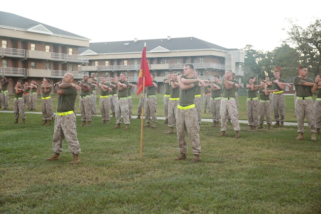 Marines with Battery A, Ground Combat Element Integrated Task Force, conduct cool-down stretches after a three-mile run aboard Marine Corps Base Camp Lejeune, North Carolina, Oct. 17, 2014. From October 2014 to July 2015, the Ground Combat Element Integrated Task Force will conduct individual and collective skills training in designated combat arms occupational specialties in order to facilitate the standards based assessment of the physical performance of Marines in a simulated operating environment performing specific ground combat arms tasks. (U.S. Marine Corps photo by Cpl. Paul S. Martinez/Released)