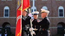 Gen. James F. Amos, the 35th Commandant of the Marine Corps, passes the colors to Gen. Joseph F. Dunford, Jr., during the change of command and subsequent retirement ceremony Oct. 17, 2014 at Marine Corps Barracks Washington, at 8th & I. After more than 44 years of military service, Amos passed the duties as senior-ranking officer of the Marine Corps to Dunford, who has now become the 36th Commandant of the Marine Corps.