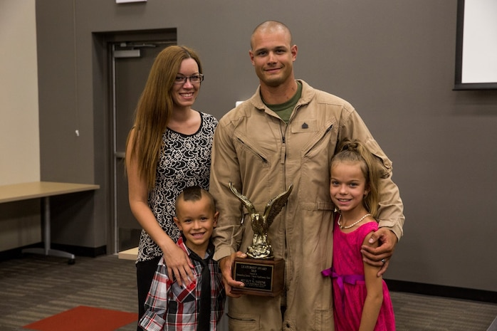 U.S. Marine Sgt. Guy Higgins poses with his family after receiving the Navy and Marine Corps Association Leadership Award Sept. 26, 2014. Higgins, 27, is from Mattoon, Illinois, and is a sniper with the Force Reconnaissance Detachment, 15th Marine Expeditionary Unit.  (U.S. Marine photo by Cpl. Anna Albrecht/Released)