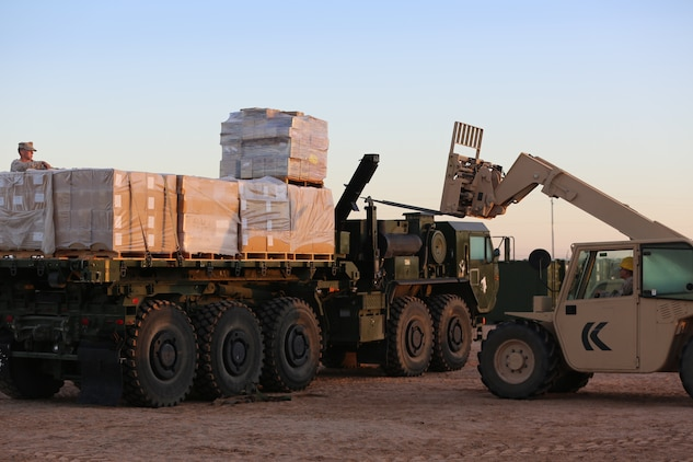 Marines with 1st Supply Battalion, Combat Logistics Regiment 15, 1st Marine Logistics Group, I Marine Expeditionary Force, provide logistical support for the Weapons and Tactics Instructor Course in Yuma, Ariz., Oct. 15, 2014. For more than a month, 1st Supply Bn. provided food, water, and other logistical services to the various forward operating bases where the WTI course Marines were operating.