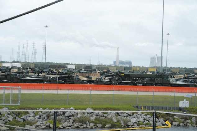 A concrete parking lot at Blount Island Command, Jacksonville, Fla., contains hundreds of military vehicles awaiting shipment to warfighters around the globe. The lot is situated adjacent to the USNS Pfc. Dewayne T. Williams, which is loaded with tons of military vehicles and metal containers.