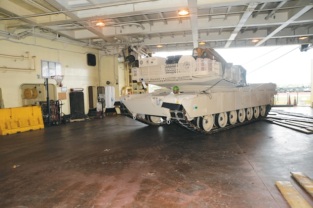 A dockworker drives a tank onto one of several decks on the USNS Pfc. Dewayne T. Williams ship at Blount Island Command, Jacksonville, Fla., recently. The vessel was loaded with tons of critical gear and equipment, which is being transported to Marines as part of operations of the Maritime Prepositioning Force Program.