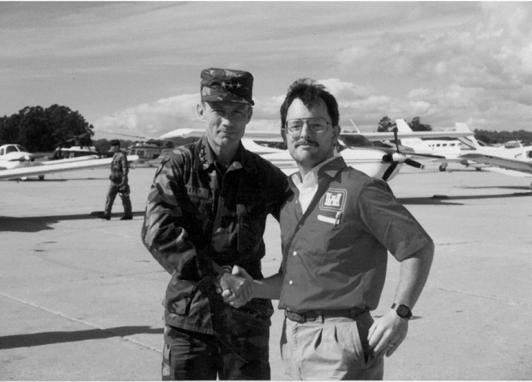 Joe Laird chased down the Chief of Engineers' chopper to get this photo with Lt. Gen. Henry Hatch in 1989 as he landed to survey the earthquake damage at Loma Prieta.