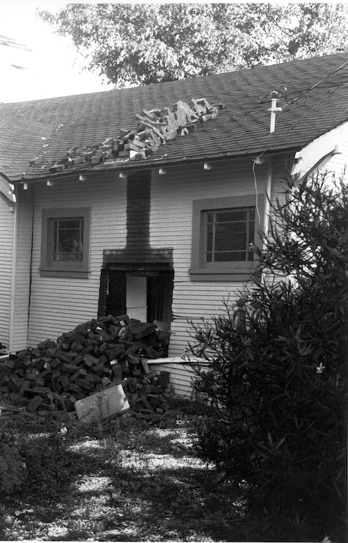 The 1989 Loma Prieta earthquake in Calilfornia left many visible scars as the chimney from this house shook all the way off the structure.