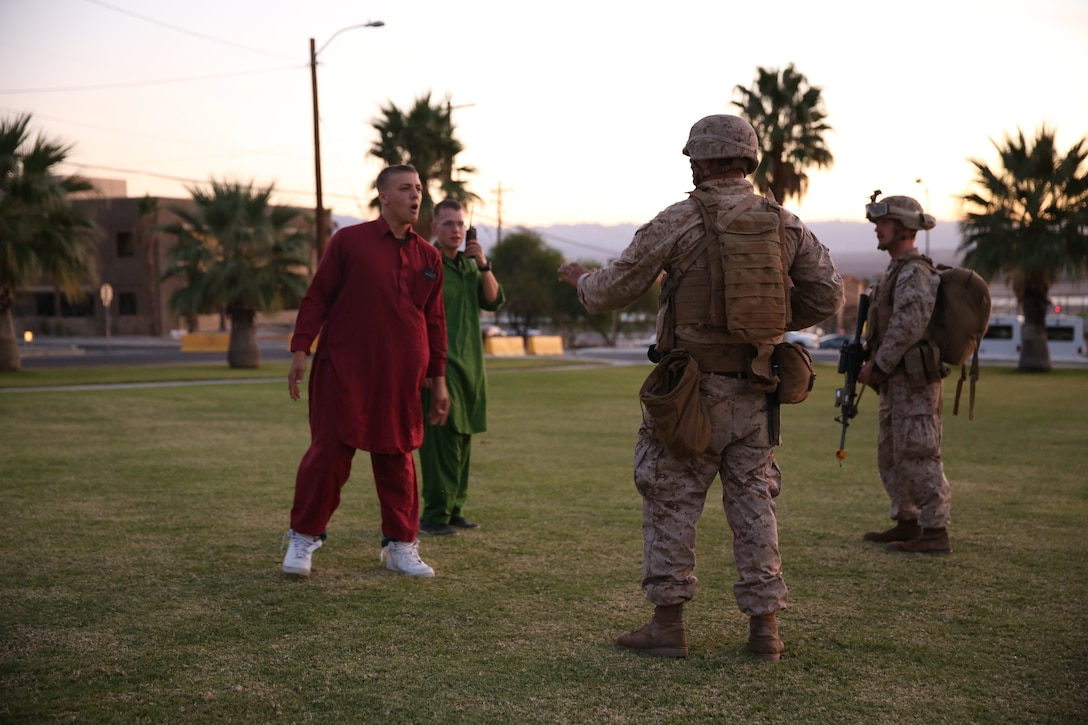 Two Marine role players attempt to get past security and board an aircraft on Lance Corporal Torrey L. Gray Field, Oct. 10, 2014. The role player's job was to harass the Marines in ways they would have to deal with in a live scenario.