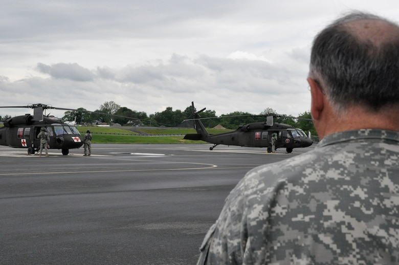 Soldiers from Detachment 1 F Company 1/126th Aviation, Delaware Army National Guard leave for Fort Hood, Texas, in UH-60 Black Hawk helicopters on June 5, 2014. U.S. Army Maj. Gen. Frank Vavala, adjutant general, Delaware National Guard, along with family members gathered to see the Soldiers off. (U.S. Army National Guard photo by Officer Candidate Wendy McDougall)