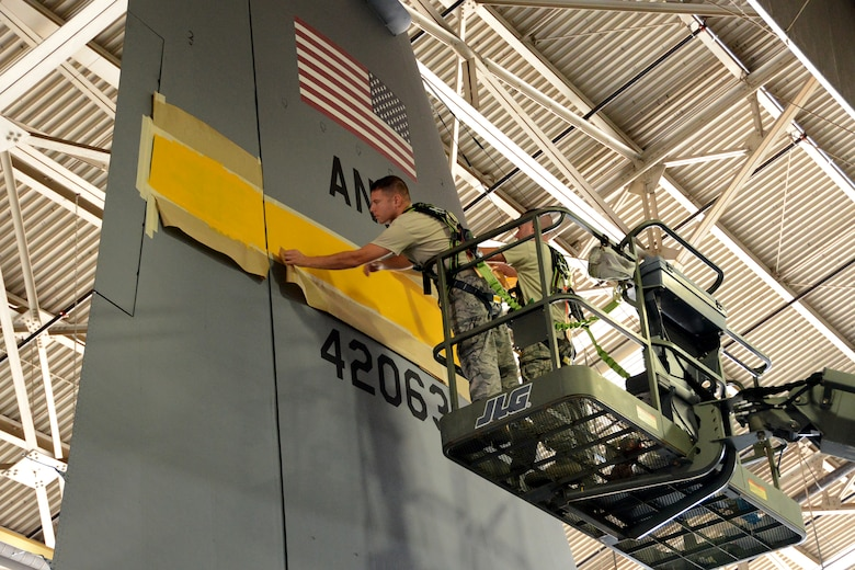 One year after the arrival of the first C-130H Hercules aircraft at Bradley Air National Guard Base, East Granby, Conn., the eighth and final aircraft receives tail paint in the hangar, Friday, October 17, 2014.  The Flying Yankees' acceptance of the final aircraft assigned to the 103rd Airlift Wing Wednesday, October 15, 20104, marks an important milestone in the unit's conversion to the C-130H mission.  (U.S. Air National Guard photo by Master Sgt. Erin McNamara)