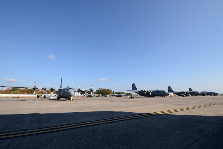 One year after the arrival of the first C-130H Hercules aircraft at Bradley Air National Guard Base, East Granby, Conn., a full fleet of aircraft adds color to the fall flightline, Friday, October 17, 2014.  The Flying Yankees' acceptance of the final of eight aircraft assigned to the 103rd Airlift Wing, Wednesday, October 15, 2014, marks an important milestone in the unit's conversion to the C-130 mission.  (U.S. Air National Guard photo by Master Sgt Erin McNamara)