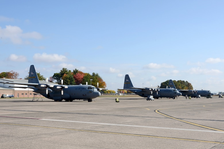 One year after the arrival of the first C-130H Hercules at Bradley Air National Guard Base in East Granby, Conn., a full fleet of aircraft adds color to the fall flight line Friday, October 17, 2014.  The Flying Yankees' acceptance of the final of eight aircraft assigned to the 103rd Airlift Wing Wednesday, October 15, 20104, marks an important milestone in the unit's conversion to the C-130 mission.  (U.S. Air National Guard photo by Master Sgt Erin McNamara)