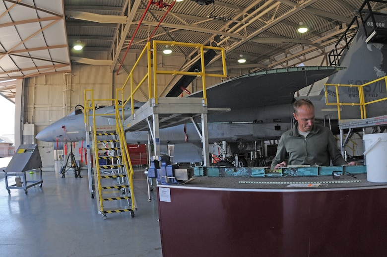 U.S. Air Force Staff Sgt. Andrew Lautenschlager, 173rd Fighter Wing F-15 crew chief, examines a crack found in a portion of the wing of the disassembled F-15 at Kingsley Field, in Klamath Falls, Ore. Oct. 16, 2014.  This aircraft is going through phase maintenance where the 173rd FW maintainers closely inspect the aircraft for cracks and other types of damage, verifying that the 30 plus year old aircraft is safe to fly.  (U.S. Air National Guard photo by Master Sgt. Jennifer Shirar/Released)