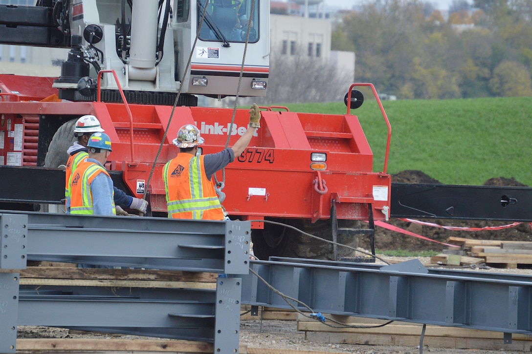 DAYTON, Ohio – Construction crews work on erecting the steel truss on the East end of the building. The 224,000 square foot building, which is scheduled to open to the public in 2016, is being privately financed by the Air Force Museum Foundation, a non-profit organization chartered to assist in the development and expansion of the museum's facilities. (U.S. Air Force photo)