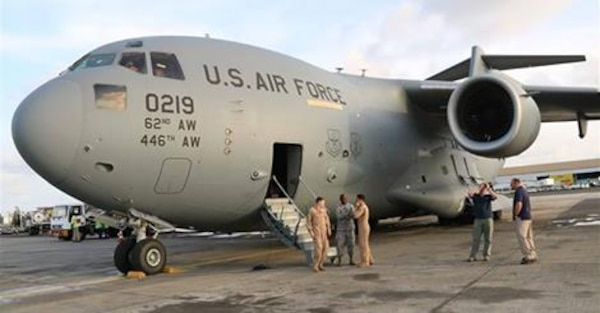 A C-17 U.S. military aircraft arrives in Liberia in September with the first shipment of increased U.S. military equipment and personnel for the anti-Ebola fight, which was promised by President Barack Obama in a Sept. 16 speech at the Centers for Disease Control and Prevention in Atlanta, Ga. Photo by Embassy of the United States of America, Monrovia, Liberia