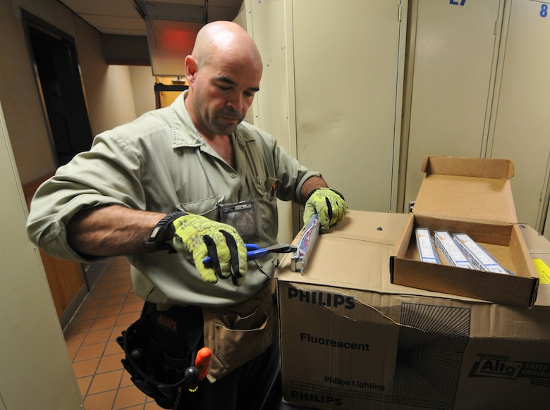 Peter Cote, electrician with the 177th Fighter Wing, New Jersey Air National Guard, prepares a new high efficiency electronic fluorescent ballast for installation in on Oct. 10, 2014. Part of the base's ongoing commitment to energy conservation, and in observation of the Dept. of Defense's October Energy Awareness Month, the base civil engineers installed the newer T8 bulbs and ballasts which combine for an energy savings of 20% over the older T12 type. (U.S. Air National Guard photo by Master Sgt. Andrew J. Moseley/Released)