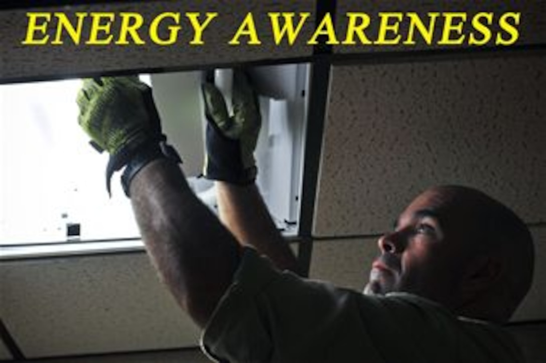 Electrician Peter Cote installs and retrofits lights with newer, higher efficiency T8 fluorescent bulbs at the New Jersey Air national Guard's 177th Fighter Wing on Oct. 9, 2014. (U.S. Air National Guard photo illustration by Master Sgt. Andrew J. Moseley/Released)