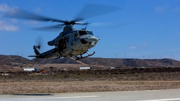 """A UH-1Y Huey with Marine Light Attack Helicopter Squadron 369 """"Gunfighters,"""" prepares to land during a familiarization flight aboard Marine Corps Air Station Camp Pendleton, Calif., Oct. 16. Pilots and crews practiced basic flight operations like landings and take offs several times in succession to hone their skills."""