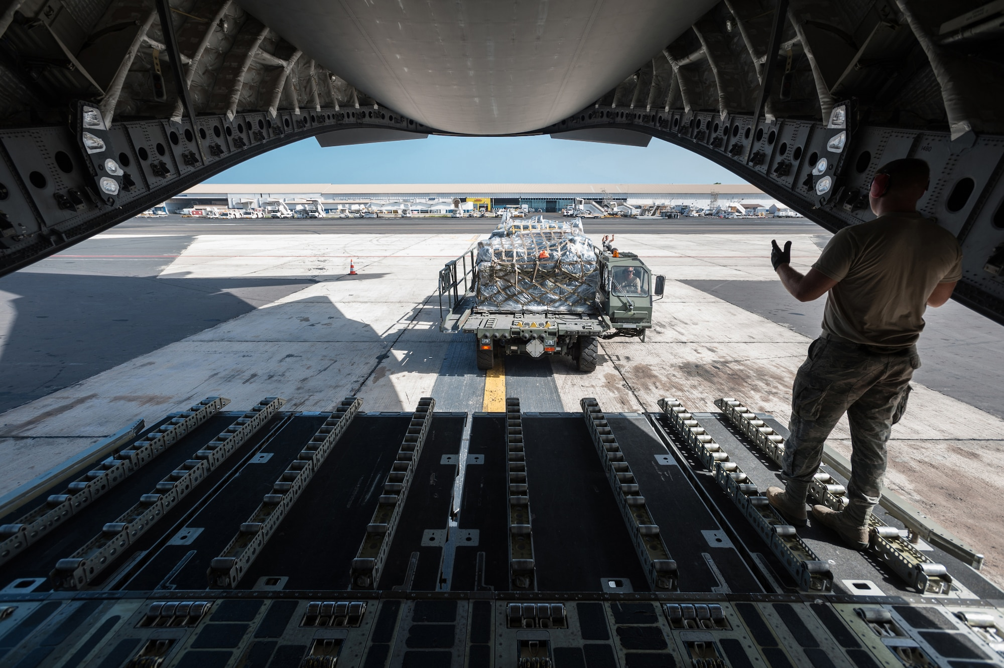 Airmen from the Kentucky Air National Guard's 123rd Contingency Response Group offload cargo pallets from a C-17 Globemaster III, Oct. 18, 2014, as part of ramp operations at Léopold Sédar Senghor International Airport in Dakar, Senegal, in support of Operation United Assistance. The Airmen are operating an intermediate staging base in Dakar to funnel humanitarian aid and military support cargo into affected areas, working in concert with Soldiers from the U.S. Army's 689th Rapid Port Opening Element to staff a Joint Task Force-Port Opening as part of the U.S. Agency for International Development-led, whole-of-government effort to respond to the Ebola outbreak. The C-17 is assigned to Travis Air Force Base, Calif. (U.S. Air National Guard photo/Maj. Dale Greer)