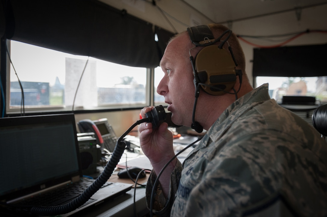 Master Sgt. Michael Skeens coordinates air movement from a mobile airfield operations center Oct. 18, 2014, at Léopold Sédar Senghor International Airport in Dakar, Senegal. Skeens and more than 70 other Airmen from the Kentucky Air National Guard's 123rd Contingency Response Group are operating a cargo hub in Senegal to funnel humanitarian supplies and military support equipment into West Africa as part of Operation United Assistance, the U.S. Agency for International Development-led, whole-of-government effort to respond to the Ebola outbreak. Skeens is a command post controller for Joint Task Force-Port Opening Senegal. (U.S. Air National Guard photo/Maj. Dale Greer)