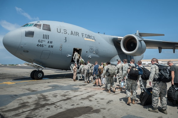 A group of 30 U.S. military personnel, including Marines, Airmen, and Soldiers from the 101st Airborne Division (Air Assault), board a C-17 Globemaster III Oct. 19, 2014, at Léopold Sédar Senghor International Airport in Dakar, Senegal. The service members are bound for Monrovia, Liberia, where U.S. troops will construct medical treatment units and train health care workers as part of Operation United Assistance, the U.S. Agency for International Development-led, whole-of-government effort to respond to the Ebola outbreak in West Africa. (U.S. Air National Guard photo/Maj. Dale Greer)