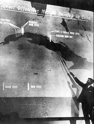 Using overhead reconnaissance photography, DIA's John Hughes, special assistant to DIA Director Lt. Gen. Joseph Carroll, conducts a televised briefing on the removal of soviet missiles from Cuba, Feb. 6, 1963. Secretary of Defense Robert McNamara asked Hughes to give the briefing in order to quell rumors that the soviets still had nuclear missiles in Cuba.