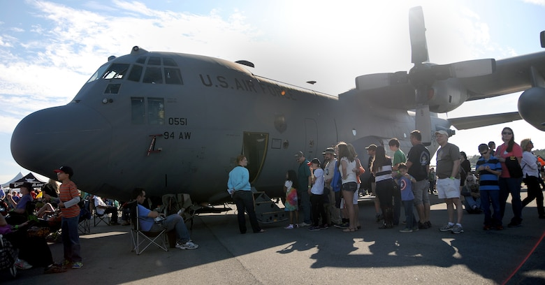 Visitors to the Wings over North Georgia air show line up to tour the cockpit of a U.S. Air Force C-130 Hercules from Dobbins Air Reserve Base, Ga. Oct. 18, 2014, at Rome, Ga. The static display was brought to WONG to help visitors better understand the capabilities of the 94th Airlift Wing. (U.S. Air Force photo by Senior Airman Daniel Phelps/Released)
