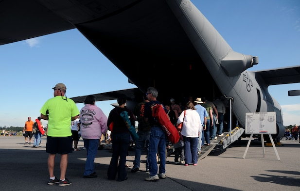 Visitors to the Wing over North Georgia air show line up to tour a U.S. Air Force C-130 Hercules from Dobbins Air Reserve Base, Ga. at Rome, Ga., Oct. 18, 2014. The 700th Airlift Squadron brought a U.S. Air Force C-130 Hercules to the WONG air show as a static display. (U.S. Air Force photo by Senior Airman Daniel Phelps/Released)