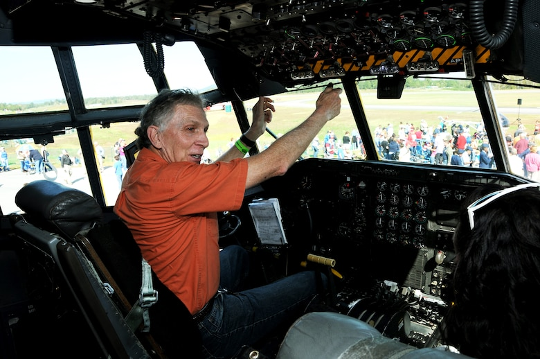 Brian Shuler, a Marietta, Ga. resident and former C-130 crew member, demonstrates differences between the one he flew in and the static from Dobbins Air Reserve Base at the Wings over North Georgia air show in Rome, Ga, Oct. 18, 2014. The 700th Airlift Squadron brought a U.S. Air Force C-130 Hercules to the WONG air show as a static display. (U.S. Air Force photo by Senior Airman Daniel Phelps/Released)