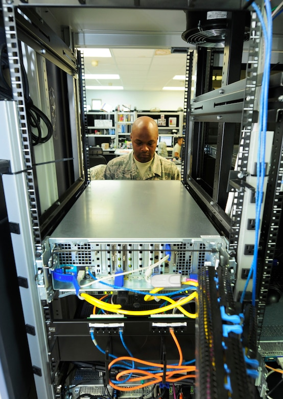 U.S. Air Force Tech. Sgt. Andre Corbett, client systems administrator for the 145th Communications Flight, applies new TIME Compliance Network Orders (TCNO) patching that  provides the level of security needed to complete mission tasking at the North Carolina Air National Guard base, Charlotte Douglas Intl. Airport, Oct. 1, 2014. Corbett makes sure that the security patches installed are working by accessing each server manually and looking for specific responses that would be given during an authorized access login and an unauthorized login. (U.S. Air National Guard photo by Master Sgt. Patricia F. Moran, 145th Public Affairs/Released)