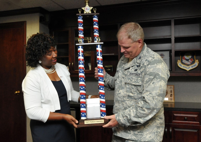 """U.S. Air Force Col. Marshall C. Collins, commander, 145th Airlift Wing and retired Lt. Col. Rose Dunlap, representative for the Combined Federal Campaign (CFC), proudly display the 2013 Greater North Carolina CFC American Eagle """"Top Perch"""" award. Collins accepted on behave of all military members and federal employees of the North Carolina Air National Guard that so generously contributed to local, national and international charities. The presentation was held at the North Carolina Air National Guard base, Charlotte Douglas Intl. Airport, June 17, 2014. (U.S. Air National Guard photo by Master Sgt. Patricia F. Moran, 145th Public Affairs/Released)"""